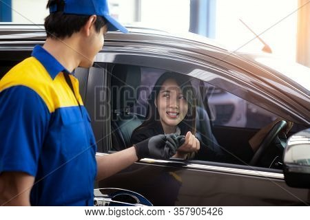 Asian Lady Got A Key From Technician After Checked Her Car In Car  Service Center, This Image Can Us