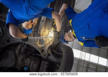 Asian Man In Car Service, Repair, Maintenance And People Concept, Happy Smiling Auto Mechanic Man Or