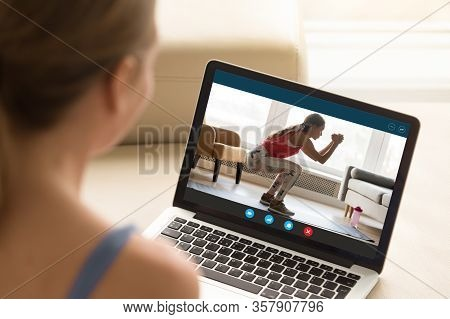 Interested Girl Watching Online Educational Fitness Workshop Training.