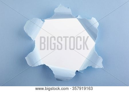 Abstract Advertising With Blue Torn Hole Paper On White Background For Concept Design. Torn Paper Sh