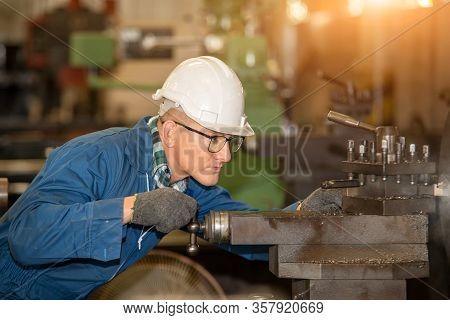Factory Worker,engineer Wearing Uniform Safety In Factory Working Machine Lathe Metal.