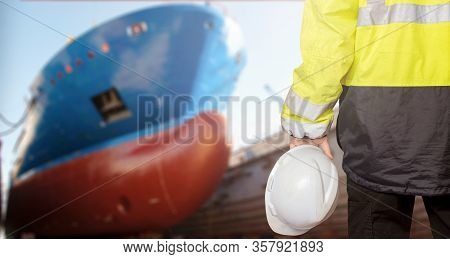 Ship Sub-designer Or Shipbuilder In Drydock With Ships Bow On A Background. Ship Design, Ship Buidin