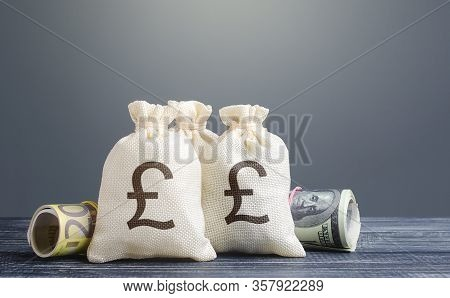 Pound Sterling Money Bags. Capital Investment, Savings. Economics, Lending Business. Banking Service
