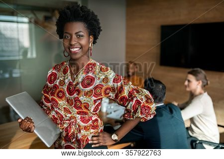 Beautiful Young Smiling Professional Black African Business Woman Holding Laptop, Coworkers Hold A M