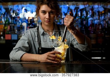 Young Bartender Hold Glass With Splashing Fresh Cocktail