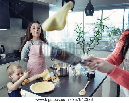 Happy family doing pancakes at home