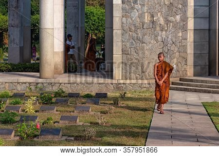 Taukkyan, Myanmar - December 30, 2019: A Young Monk Walking In Taukkyan War Cemetery. This Is A Ceme