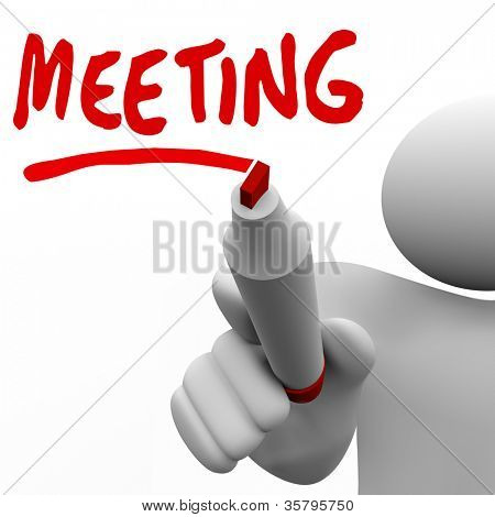 A man writing the word Meeting on a board with a marker to k ick off a discussion, networking or information sharing event