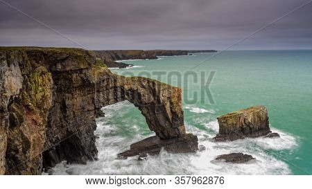 The Green Bridge Of Wales. A Dramatic, Coastal Rock Arch, Located On The Pembrokeshire Coastline, In