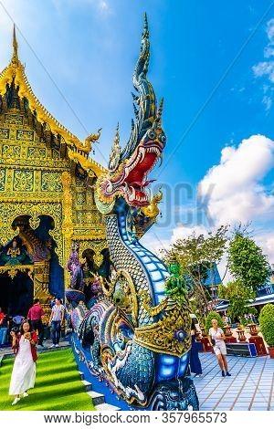 Chiang Rai, Thailand - 6.11.2019: The Dragon Statue At Blue Temple (wat Rong Suea Ten) In Chiang Rai