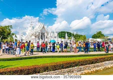 Chiang Rai, Thailand - 6.11.2019: Tourists Are Visiting The Wat Rong Khun (white Temple). Famous Whi