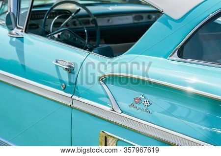 Rushmoor, Uk - April 19: Chevrolet Impala Badge And Chromed Door Panel On A Classic American Vehicle