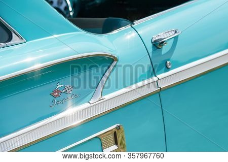 Rushmoor, Uk - April 19: Chevrolet Impala Badge And Chromed Trim On A Classic American Vehicle In Ru