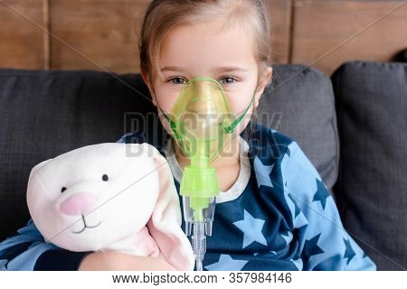 Asthmatic Kid Using Respiratory Mask And Holding Soft Toy