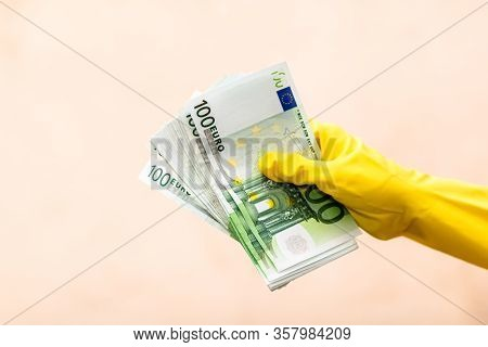 World Money Concept, Hand With Gloves Receiving, Giving Or Holding 100 Euro Banknote, Isolated On Bl