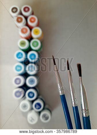 Paint Brushes. Photography Tools For Fine Art And Pictorial Art. Brush Painting On Canvas In Orange