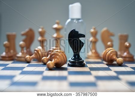 Coronavirus Concept Image Chess Pieces And Hand Sanitizer On Chessboard Illustrating Global Struggle