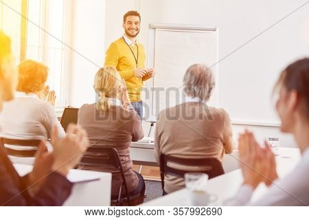 Lecturer in adult education gives a lecture to a group