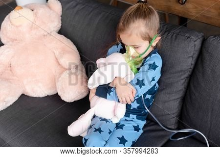 Asthmatic Kid Using Respiratory Mask While Hugging Soft Toy
