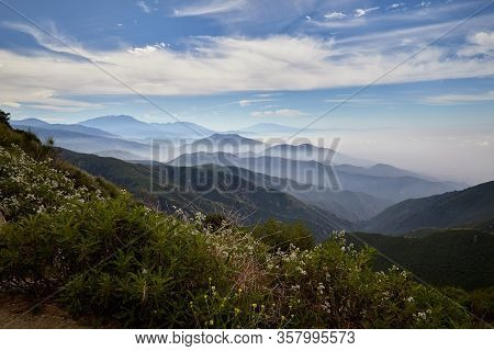 View Of The San Bernardino Mountains With Fog / Clouds Floating Over The Valley Near Lake Arrowhead