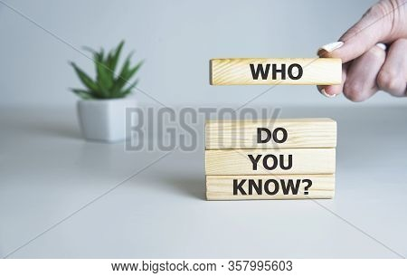 Who Do You Know Text On Wooden Cubes, Business Concept.