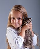 Portrait of adorable little girl and her kitten poster