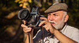 Professional Nature Photographer. Bearded Pensioner Take Travel Photo. Vintage Retro Photo Camera. M