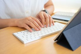Work From Home Young Freelancer Or Businessman Working At Home Office With Smartphone Tablet. Workin