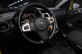 Opel Corsa - Close-up Of The Dashboard, Player, Steering Wheel, Accelerator Handle, Buttons, Seats.n