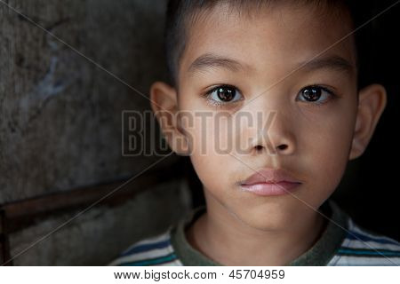 Portrait of an Asian boy from impoverished area in the Philippines