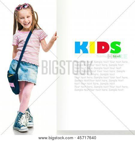 little fashion girl  behind a white board