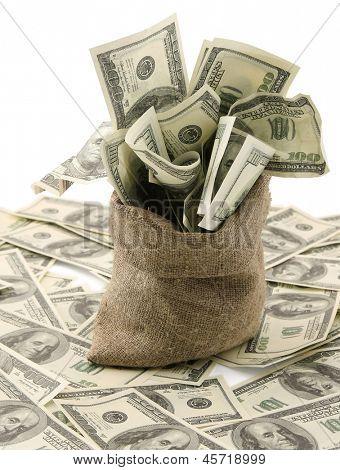 Saco de dinero con billetes de cien dólares de la lona