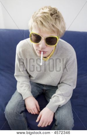 Portrait Of Young Blond Man Smoking Cigarette