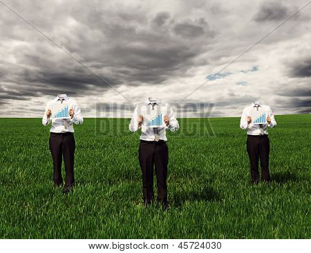 faceless businessmen in formal wear showing growth chart