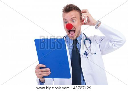 clown doctor unable to read the notes on his notepad and looking foolish
