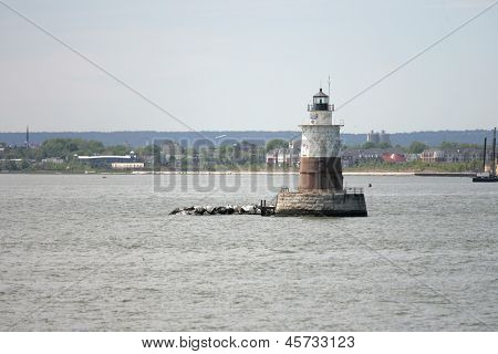 BAYONNE, NJ - MAY 17: Robbins Reef Lighthouse is shown on May 17, 2013 in Upper New York Bay, Bayonne, NJ. The Robbins Reef Light Station was built in 1883. .