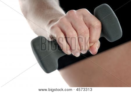 Hand Of A Healthy Young Female Excersing With Weights