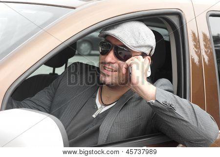 Happy Businessman Driver Talking