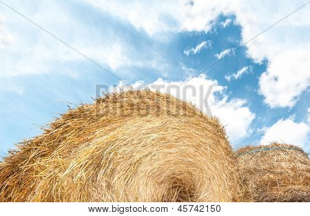 Haystack Outdoors, Sky With Clouds In Background.