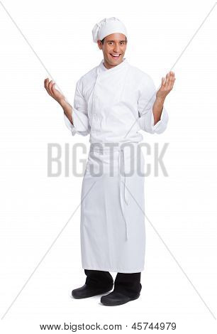 Male Chef Smiling And Making Hand  Gesturing I