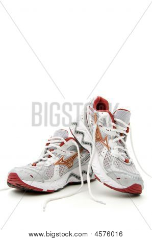 Pair of running shoes on a white background poster