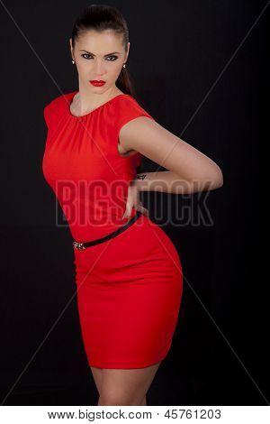 Beautiful Woman Posing In Red Dress