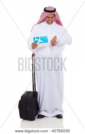 middle eastern businessman checking flight time isolated on white