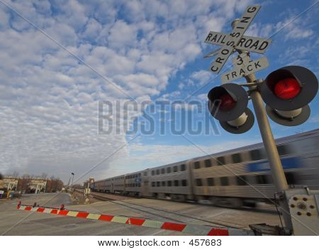 Commuter Train At Rail Crossing