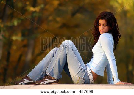 Brunette Sitting On Road