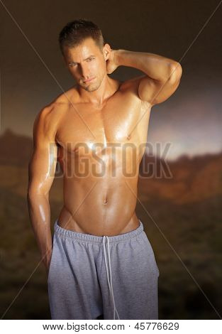Portrait of a sexy shirtless young man outdoors