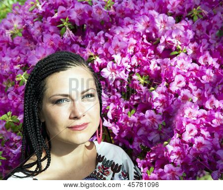 Beautiful blue-eyed woman with the african pigtails