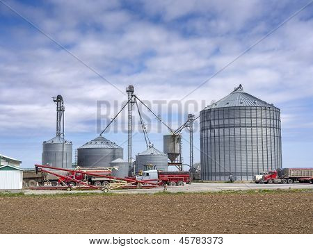 Agricultural grain elevator building for corn storage in silos poster