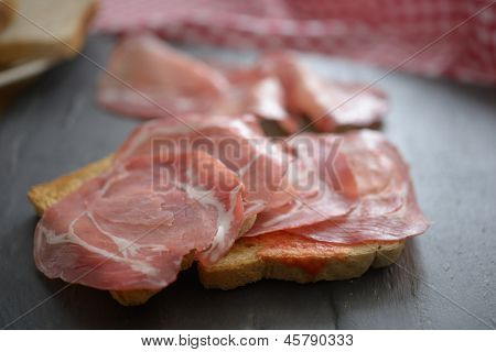 Sandwiches with jamon on a slate surface