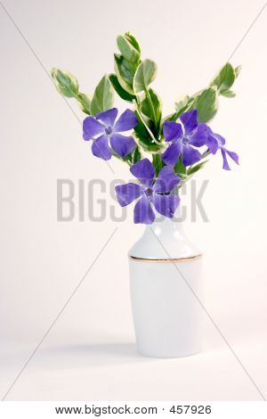 still life computer generated image of purple flowers in a white vase poster